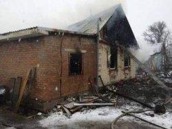 На Киевщине ревнивец стрелял в женщину и сжег ее дом