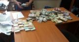 НАБУ провело обыски в управлении ГФС, найдены $300 тыс., €100 тыс. и 1,5 млн грн