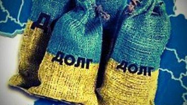 НБУ: Украина должна выплатить 10 млрд долларов госдолга